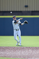 Michigan Wolverines second baseman Riley Bertram (12) makes a throw to first base against the Michigan State Spartans on March 22, 2021 in NCAA baseball action at Ray Fisher Stadium in Ann Arbor, Michigan. Michigan State beat the Wolverines 3-0. (Andrew Woolley/Four Seam Images)