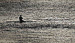 A lone rower gets some morning exercise on San Francisco Bay, California.