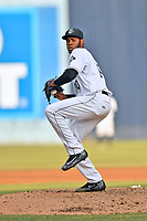 Asheville Tourists starting pitcher Antonio Santos (10) delivers a pitch during a game against the Rome Braves at McCormick Field on June 12, 2017 in Asheville, North Carolina. The Tourists defeated the Braves 7-0. (Tony Farlow/Four Seam Images)