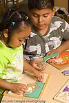 Preschool high school volunteer working with child