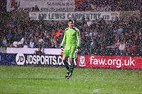 Pictured: Wales goalkeeper Connor Roberts in the pouring rain. Monday 19 May 2014<br />