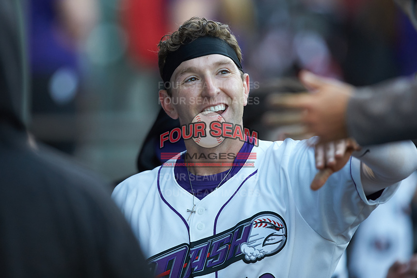 Jordan George (12) of the Winston-Salem Dash is all smiles after scoring a run during the game against the Wilmington Blue Rocks at BB&T Ballpark on April 15, 2019 in Winston-Salem, North Carolina. The Dash defeated the Blue Rocks 9-8. (Brian Westerholt/Four Seam Images)