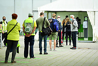 23rd May 2020, Volkswagen Arena, Wolfsburg, Lower Saxony, Germany; Bundesliga football,VfL Wolfsburg versus Borussia Dortmund; a Hygiene centre and pass check for the official staff