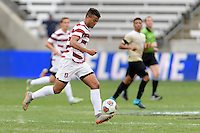 Houston, TX - Friday December 11, 2016: Brian Nana-Sinkam (8) of the Stanford Cardinal brings the ball up the field against the Wake Forest Demon Deacons at the NCAA Men's Soccer Finals at BBVA Compass Stadium in Houston Texas.