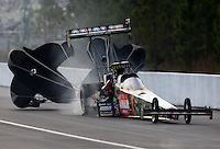 Mar 15, 2014; Gainesville, FL, USA; NHRA top fuel dragster driver Terry McMillen has a tire go down after an engine explosion during qualifying for the Gatornationals at Gainesville Raceway Mandatory Credit: Mark J. Rebilas-USA TODAY Sports