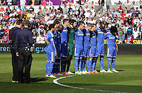 Sunday, 13 April 2014<br /> Pictured: Chelsea players observe a minute's silence before kick off.<br /> Re: Barclay's Premier League, Swansea City FC v Chelsea at the Liberty Stadium, south Wales,