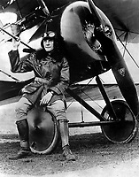 Lt. Earl Carroll, prominent composer, is now a full-fledged aviator in the U.S. Service.  He is shown beside his fast scout machine, Ca.  1918. IFS. (War Dept.)<br /> Exact Date Shot Unknown<br /> NARA FILE #:  165-WW-432-P1524<br /> WAR & CONFLICT BOOK #:  594