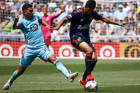 ST PAUL, MN - JULY 18: Emanuel Reynoso #10 of Minnesota United FC and Abdoulaye Cissoko #92 of the Seattle Sounders FC during a game between Seattle Sounders FC and Minnesota United FC at Allianz Field on July 18, 2021 in St Paul, Minnesota.