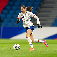 LE HAVRE, FRANCE - APRIL 13: Christen Press #23 of the USWNT dribbles during a game between France and USWNT at Stade Oceane on April 13, 2021 in Le Havre, France.