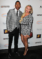 HOLLYWOOD, LOS ANGELES, CA, USA - SEPTEMBER 18: Nick Cannon, Nicole Paxson arrive at the 'Get Lucky For Lupus' 6th Annual Poker Tournament held at Avalon on September 18, 2014 in Hollywood, Los Angeles, California, United States. (Photo by Celebrity Monitor)