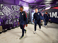ORLANDO, FL - NOVEMBER 15: Reggie Cannon #20 of the United States walks through the tunnel out to the field during a game between Canada and USMNT at Exploria Stadium on November 15, 2019 in Orlando, Florida.