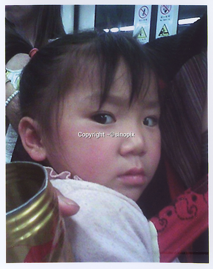 Nameless girl (4). Missing on Line 6 Shanghai Underground along with a mid-aged woman.  Girls in China are increasingly targeted and stolen as there is a shortage of wives as the gender imbalance widens with 120 boys for every 100 girls..PHOTO BY SINOPIX