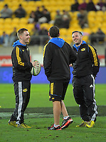 Assistant S&C coaches Cormac Ryan and Phil Maguire chat with assistant coach Jason Holland during the Super Rugby match between the Hurricanes and Blues at Westpac Stadium, Wellington, New Zealand on Saturday, 2 July 2016. Photo: Dave Lintott / lintottphoto.co.nz