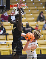 Little Rock Central Annor Boateng (12) blocks Bentonville Abel Hutchinson (2), Saturday, November 14, 2020 during a basketball game at Bentonville High School in Bentonville. Check out nwaonline.com/201115Daily/ for today's photo gallery. <br /> (NWA Democrat-Gazette/Charlie Kaijo)