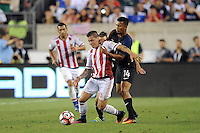 Philadelphia, PA - June 11, 2016: Paraguay forward Juan Iturbe (15) and USA defender Michael Orozco (14) during a Copa America Centenario Group A match between United States (USA) and Paraguay (PAR) at Lincoln Financial Field.