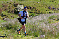 Pictured: A man jogs on one of the paths leading to Pen-y-Fan, one of the Brecon Beacons summits near Storey Arms in the Brecon Beacons, Wales, UK. Sunday 13 June 2021<br /> Re: High temperatures and sunshine has been forecast for most of the UK.
