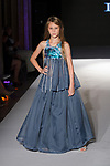 Model walks runway in an outfit from the De Lauraine Designs Spring Summer 2020 collection runway show for The Society Fashion Week Spring Summer 2020 during New York Fashion Week, on September 7, 2019.