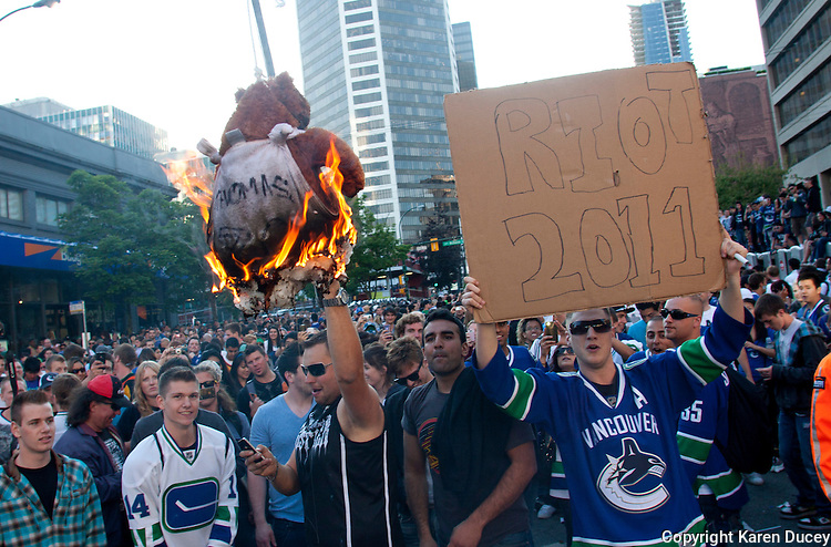 A bear representing the Buins is burned on the downtown streets of Vancouver,BC after the Canucks were defeated by the Boston Bruins in the Stanly Cup on June 15, 2011. Riots would soon follow. (photo copyright Karen Ducey)