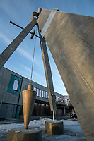 "Morning sun on Pat Garley's ""Changing the World"" engineering sculpture outside UAA's Engineering and Computation and Natural Sciences Buildings."