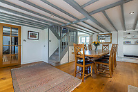 BNPS.co.uk (01202 558833)<br /> Pic: Savills/BNPS<br /> <br /> Pictured: The dining room.<br /> <br /> A former tidal mill next to an impressive viaduct that looks like the perfect backdrop for a children's book is on the market for £3.5m.<br /> <br /> The Old Mill is over 600 years old and would be an ideal home for Swallows and Amazons or The Railway Children-inspired adventures.<br /> <br /> The impressive Grade II listed six-bedroom house has its own private harbour and panoramic views of the much-photographed Forder Railway Viaduct.<br /> <br /> It is only the second time the property in Cornwall has been on the market since 1886 and agents Savills say it is a once in a lifetime opportunity.