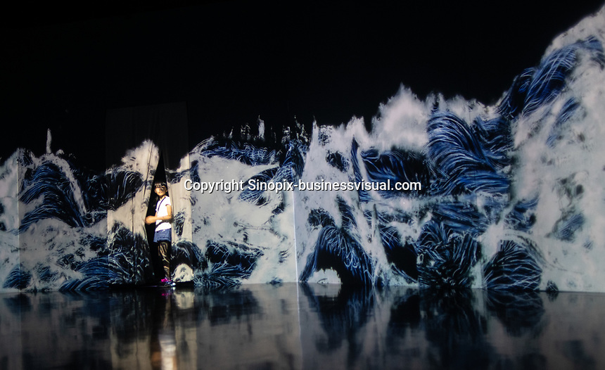 "An installation similar to Hokosai's ""wave / tsunami"" woodblock print in Team Lab's Borderless digital museum in Tokyo, Japan, July, 2019. The digital museum is one of Tokyo's most popular attractions and uses innovative digital audio-visual displays."
