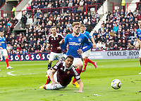 02.05.2015.  Edinburgh, Scotland. Scottish Championship. Hearts versus Rangers. Hearts Osman Sow goes down in the box after a tackle from Rangers Marius Zaliukas