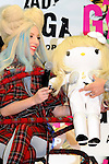 December 1st, 2013 : Tokyo, Japan - Lady Gaga, an American pop music star, posed for photographs with Hallo Kitty, a Japanese popular character that was going to be put up for auction to raise money for people who were suffered by the Great East Japan Earthquake, at a press conference about her new album, ARTPOP, at Roppongi Hills, Roppongi, Minato, Tokyo, Japan on December 1, 2013. (Photo by Koichiro Suzuki/AFLO)