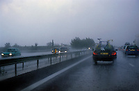 Traffic on the A9 Highway during a rain storm, Beziers, France.