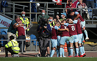 29th August 2021; Turf Moor, Burnley, Lancashire, England; Premier League football, Burnley versus Leeds United: Chris Wood of Burnley celebrates with his team mates after scoring in the 61st minute