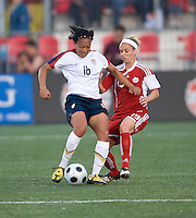 Angela Hucles, Kelly Parker. The US Women's National Team defeated the Canadian Women's National Team, 4-0, at BMO Field in Toronto during an international friendly soccer match on May 25, 2009.