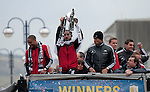 Ashley Williams, Chico Flores and Michel Vorm celebrating winning the Captial Cup trophy at Wembley on Sunday with an open top bus homecoming parade through the centre of Swansea.