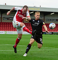 Fleetwood Town's Glenn Whelan clears under pressure from Lincoln City's Anthony Scully<br /> <br /> Photographer Chris Vaughan/CameraSport<br /> <br /> The EFL Sky Bet League One - Fleetwood Town v Lincoln City - Saturday 17th October 2020 - Highbury Stadium - Fleetwood<br /> <br /> World Copyright © 2020 CameraSport. All rights reserved. 43 Linden Ave. Countesthorpe. Leicester. England. LE8 5PG - Tel: +44 (0) 116 277 4147 - admin@camerasport.com - www.camerasport.com