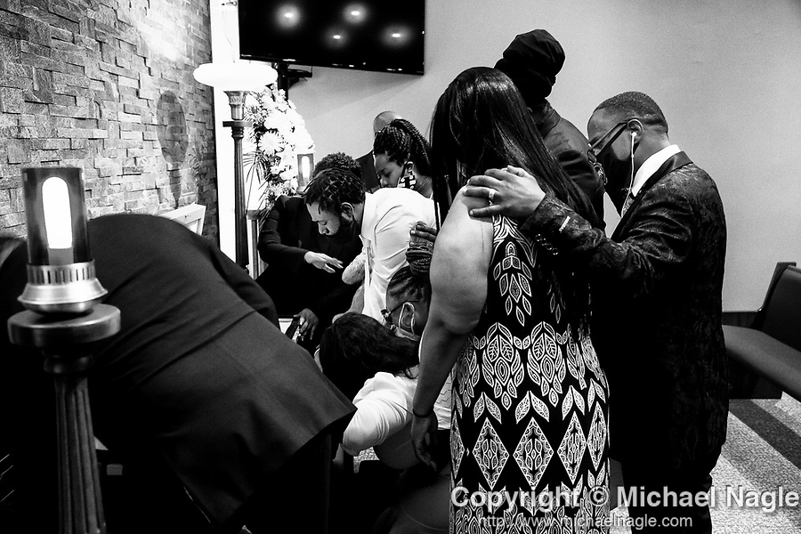 Family members mourn the death of one year-old Davell Gardner Jr. during a final viewing at the Lawrence H. Woodward Funeral Home on July 27, 2020 in the Brooklyn borough of New York City.  Gardner was shot and killed earlier this month during a cookout in front of his home along with three others.  Photograph by Michael Nagle