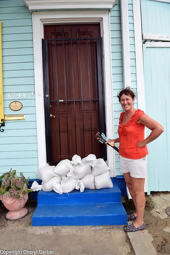 Betsy Rayner, homeowner in the Marigny neighborhood, prepares for Tropical Storm Barry, which is expected to make landfall as a Category 1 hurricane on Sat., in New Orleans, Fri., July, 12, 2019.