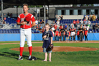 Batavia Muckdogs pitcher Max Garner #21 stands with a young fan as Star of the Game during the national anthem before a game against the Mahoning Valley Scrappers on June 21, 2013 at Dwyer Stadium in Batavia, New York.  Batavia defeated Mahoning Valley 3-2.  (Mike Janes/Four Seam Images)