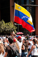Venezuela: Caracas,15/02/14 <br /> A young man waving a flag of Venezuela during a protest march of thousands of students calling for the release of  young arrested in last Feb12 protest, where two students and a member of a  pro-government paramilitary group killed.Carlos Hernandez/Archivolatino