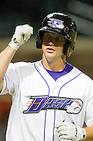 Jake Oester #16 of the Winston-Salem Dash fist bumps a teammate after hitting a solo home run against the Frederick Keys at BB&T Ballpark on May 29, 2012 in Winston-Salem, North Carolina.  The Dash defeated the Keys 8-7.  (Brian Westerholt/Four Seam Images)