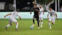 LAKE BUENA VISTA, FL - JULY 18: Mark-Anthony Kaye #14 of LAFC is pressured by Joe Corona #15 of LA Galaxy and Emiliao Insúa #3 of LA Galaxy during a game between Los Angeles Galaxy and Los Angeles FC at ESPN Wide World of Sports on July 18, 2020 in Lake Buena Vista, Florida.