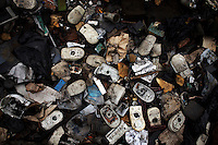 Computer mice lie on the ground at Agbogbloshie dump, which has become a dumping ground for computers and electronic waste from all over the developed world. Hundreds of tons of e-waste end up here every month. It is broken apart, and those components that can be sold on, are salvaged.
