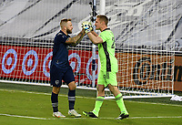 KANSAS CITY, KS - NOVEMBER 22: Johnny Russell #7 and Tim Melia #29 of Sporting KC pump each other up as the penalty shoot out is started with a score by Russell before a game between San Jose Earthquakes and Sporting Kansas City at Children's Mercy Park on November 22, 2020 in Kansas City, Kansas.