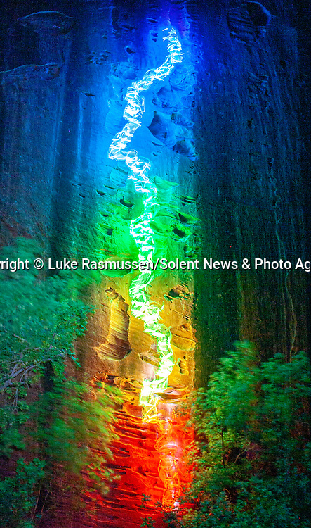 """Pictured:  A 2 minutes 18 seconds exposure at Kolob Canyons, Zion National Park, UT<br /> <br /> Bright bolts of colourful light snake their way across mountains and cliffs.  The striking images were created by a rock climber who wrapped LED lights around his body before capturing long exposure shots of his route.<br /> <br /> Luke Rasmussen took the photos in the deserts of Nevada, in the United States, and admits that his method of 'freezing time in a moment' is unusual.  The 28 year old photographer said: """"Wearing a sweater full of lights and climbing through the darkness of night is certainly a different experience than most climbers will get.  SEE OUR COPY FOR DETAILS.<br /> <br /> Please byline: Luke Rasmussen/Solent News<br /> <br /> © Luke Rasmussen/Solent News & Photo Agency<br /> UK +44 (0) 2380 458800"""