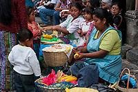 Antigua, Guatemala.  Women Selling Roasted Corn on the Cob, Plaza de Armas.  Semana Santa.