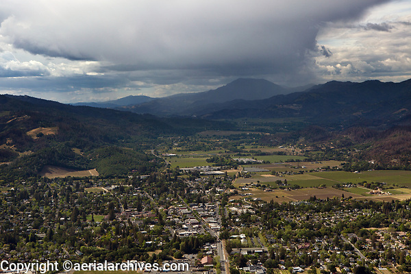aerial photograph of St. Helena towards Mount St. Helena, Napa County, California in spring during unsettled weather