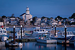 Dawn lights up the waterfront in Provincetown, Cape Cod, MA, USA