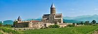 Pictures & images of the medieval Alaverdi St George Cathedral & monastery complex, 11th century, near Telavi, Georgia (country). <br /> <br /> At 50 meters high Alaverdi St George Cathedral was once the highest cathedral in Georgia (now its the nes Tblisi cathedral). The cathedral is part of a Georgian Orthodox monastery founded by the monk Joseph [Abba] Alaverdeli, who came from Antioch and settled in Alaverdi. On the UNESCO World Heritage Site Tentative List.