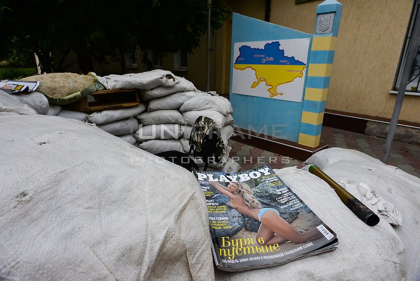 Playboy magazine on the sand bag trenches set up by Pro-Russian militia at Sverdovka Border guard
