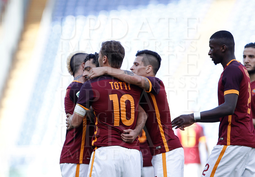 Calcio, Serie A: Roma vs Sassuolo. Roma, stadio Olimpico, 20 settembre 2015.<br /> Roma's Mohamed Salah, second from left, celebrates with teammates after scoring during the Italian Serie A football match between Roma and Sassuolo at Rome's Olympic stadium, 20 September 2015.<br /> UPDATE IMAGES PRESS/Isabella Bonotto