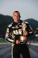 Jun. 17, 2012; Bristol, TN, USA: NHRA top fuel dragster driver Tony Schumacher poses for a portrait after winning the Thunder Valley Nationals at Bristol Dragway. Mandatory Credit: Mark J. Rebilas-