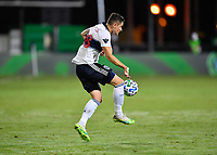 LAKE BUENA VISTA, FL - JULY 26: Jake Nerwinski of Vancouver Whitecaps FC settles the ball during a game between Vancouver Whitecaps and Sporting Kansas City at ESPN Wide World of Sports on July 26, 2020 in Lake Buena Vista, Florida.
