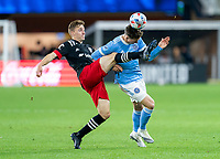 WASHINGTON, DC - APRIL 17: Julian Gressel #31 of D.C. United clears the ball away from Malte Amundsen #12 of New York City FC during a game between New York City FC and D.C. United at Audi Field on April 17, 2021 in Washington, DC.